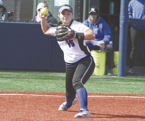 San Mateo third baseman Lauren Quirke throws to first during the Bulldogs' 8-2 win over a Delta College team that is ranked No. 6 in Northern California. CSM is the state's top-ranked team. Photo by Nathan Mollat/Daily Journal