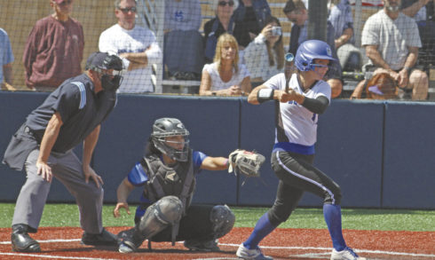 College of San Mateo's Allie Stines, a sophomore out of Capuchino, rips a three-run triple down the right-field line during the Bulldogs' 10-1 win over Solano in the first game of the best-of-three regional tournament. Game 2 is at noon Saturday. Photo by Nathan Mollat/Daily Journal