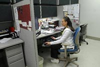 Misty Blue Foster works in her office space in the cardiology department at the Veteran's Hospital in Palo Alto.