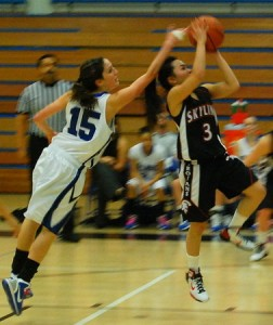 Skyline College's Rachelle Hwee (right) attempts a layup while defended by College of San Mateo's Nicole McDonald in a Coast-North opener in San Mateo on Wednesday, Jan. 5, 2011. CSM won 81-68.