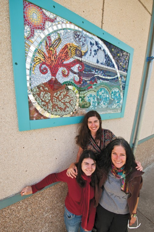 Delma Soult, top, of La Honda, Krestin Melanson, left, of Burlingame, and Catherine Favre, of Half Moon Bay, have created a mosaic mural for La Honda Elementary School. The art was part of a project for a class at the College of San Mateo.