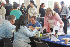 Job hunters lined up at the Pacific Gas and Electric table at the College of San Mateo yesterday in an event hosted by U.S. Rep. Jackie Speier, D-San Mateo. Bill Silverfarb / Daily Journal