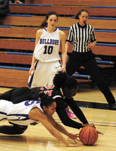 CSM's Nicole McDonald looks on as teammate Vanessa Castillo and a San Francisco player dive for a loose ball