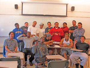 Teacher Jon Kitamura with members of the College of San Mateo football team.