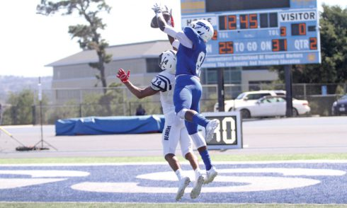 CSM receiver Rajae Johnson has a potential touchdown pass broken up by American River cornerback Troy Dangerfield in the Bulldogs' 21-20 loss Saturday at College Heights Stadium. Photo by Terry Bernal.