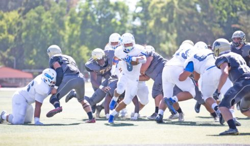 Running back Cameron Taylor totaled 16 carries for 77 yards and a touchdown for CSM Saturday at San Joaquin Delta. Photo by Patrick Nguyen.