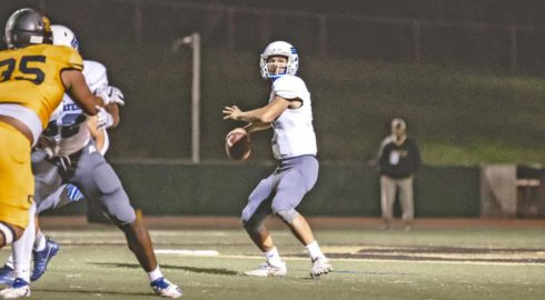CSM quarterback Kamalii Akina looks downfield for a 35-yard touchdown pass in the third quarter of Saturday's 31-17 win over Chabot College in Hayward. Photo by Lauren Anderson.
