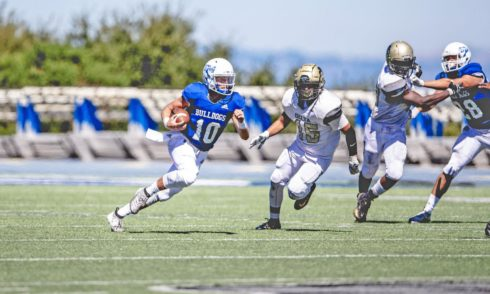 CSM freshman Luke Bottari rushes in Saturday's home opener, a 43-3 win over San Joaquin Delta at College Heights Stadium. Photo by Patrick Nguyen