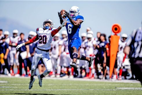 CSMwide receiver Connell Ryans while defended by American River defensive back Cameryn Walker in the Bulldogs' third straight win to start the year Saturday at College Heights Stadium. Photo by Patrick Nguyen