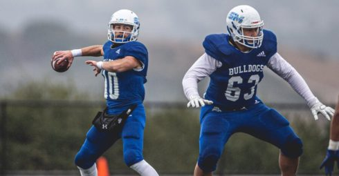 College of San Mateo quarterback Luke Bottari, No. 10, attempts a pass as offensive lineman Daniel Taumalolo protects him during a 41-0 rout of Modesto in the Northern California title game at College Heights Stadium in San Mateo on Nov. 30, 2019. (Patrick Nguyen / CSM Athletics)