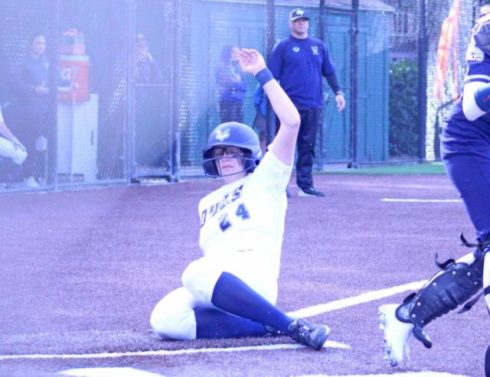 Aubrie Businger slides into home during a game last season when Oregon Tech played at Menlo College. Businger is one of many CSM transfers playing for four-year softball programs in Oregon.