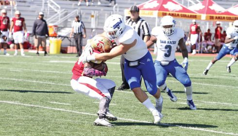 CSM?linebacker Colt Doughty tackles De Anza running back Joshua Jackson for a loss in the Bulldogs 58-12 win Saturday at De Anza College in the Bay 6 Conference opener.