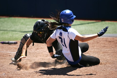 CSM's Brooke Ramsey slides home to score the winning run in the seventh inning Sunday.