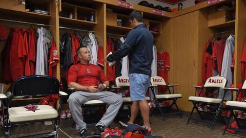 Daniel Nava speaks with beat reporter Alden Gonzalez at Angels camp. Photo by: Matt Brown/Angels