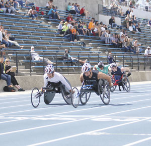 Terry Bernal/Daily Journal Five-time Paralympic Games medalist Josh George edges Brian Siemann to win gold in a 100-meter dash Saturday at the College of San Mateo.
