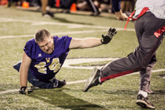"""Dave Stevens, who was born without his legs, is a seven-time Emmy Award winner who has had a 19-year career at ESPN. In 2013, Stevens was """"drafted"""" by the Wounded Warriors Amputee Football Team as a nonmilitary recruit to help motivate the veterans and able-bodied athletes and has played quarterback and defense. (Photo courtesy of Wounded Warriors Amputee Football Team) (Trevor Dayley)"""