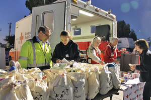 Belmont flooding victims received goods and other items at an event Monday night.