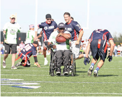 Wounded Warrior Amputee Football Team running back Kevin Patton gets past the defense to take a touchdown carry to the end zone Saturday at College of San Mateo in the fifth annual pre-Super Bowl charity game between the WWAFT and the NFL Alumni. While celebrity hip-hop artist Snoop Dogg headlined the event, the WWAFT stole the show with a 49-35 victory.